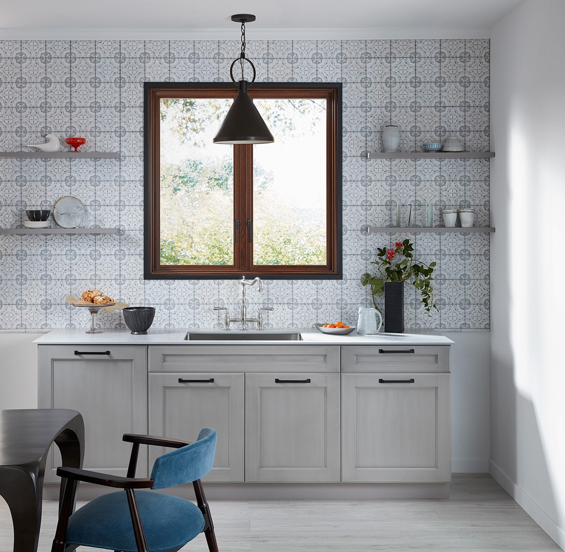 kitchen sink and counter with patterned back splash